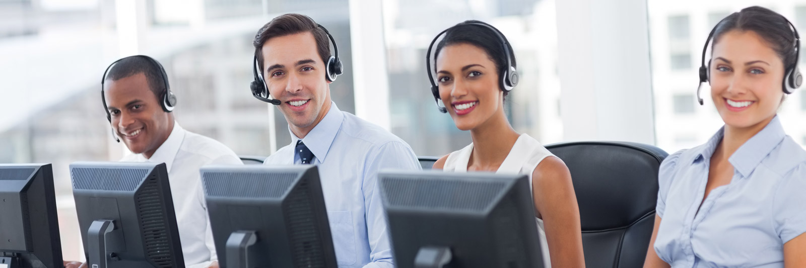 a group of young customer service representatives with headsets